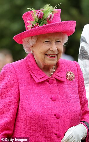Pink perfection: Typically polished, the Queen brought a splash of colour to proceedings with her eye-catching tweed coat and matching hat, pictured