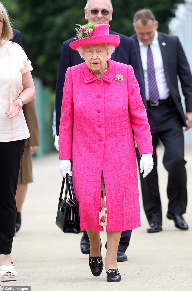 However the active royal did ask an assistant to temporarily hold her famous Launer bag, joking: