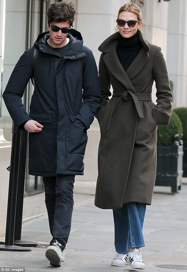 Walking in step: Karlie and her businessman boyfriend have been in a relationship for three years, since they first met in 2012