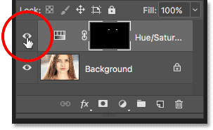 Clicking the layer visibility icon for the Hue/Saturation adjustment layer.