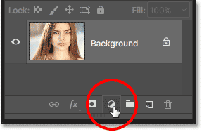Clicking the New Fill or Adjustment Layer icon in the Layers panel in Photoshop.